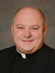 Rev. Jacek Junak, C.R.