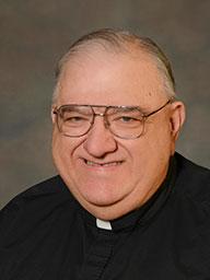 Rev. Louis F. Tosto